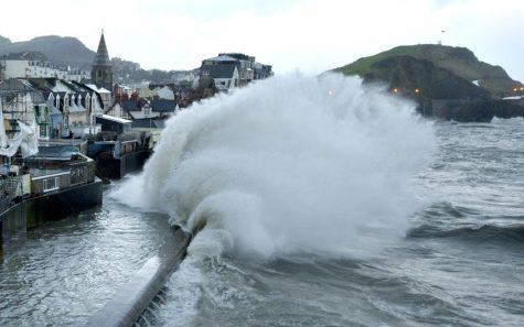 Wave slams coast during a storm surge event.