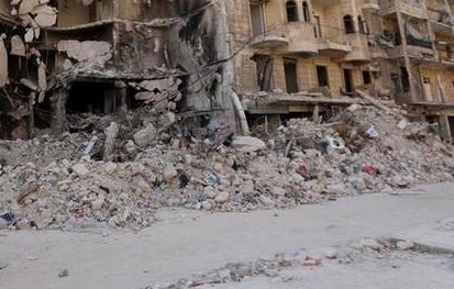 Piles of broken down buildings fully cover a street in  Aleppo after a series of suicide bombings from the rebel Troops, which have left dozens of Syrians dead.