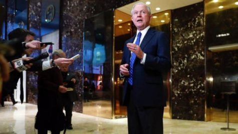 Jeff Sessions (R-AL) visits Trump tower in December to meet with the president-elect. Trump has said he will appoint Sessions as attorney general despite Session's past controversial remarks.