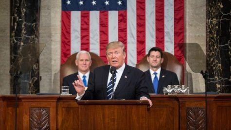 Trump giving a speech to Congress; Mike Pence and Paul Ryan are behind him.