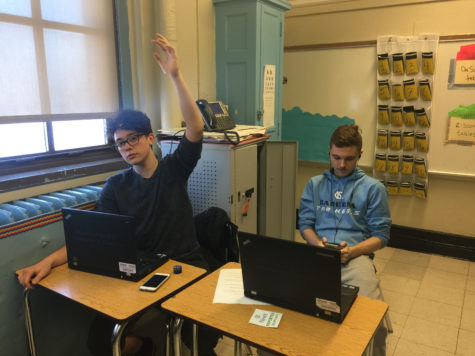 Photograph obtained from iSchool. Cade Smith left, and Kamil Kuzminski are in class doing work.