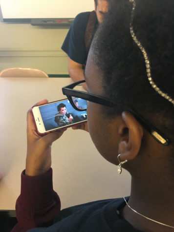 Kai Huntt, a sophomore at the NYC iSchool, watching a clip of Keeping Up With the Kardashians during advisory.