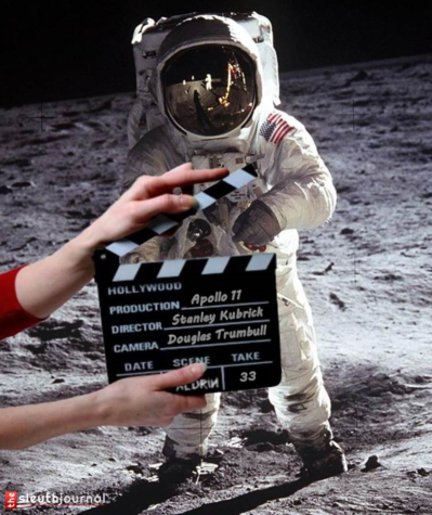 A comedic photo of Neil Armstrong in front of a clapperboard for the filming of the Apollo 11.