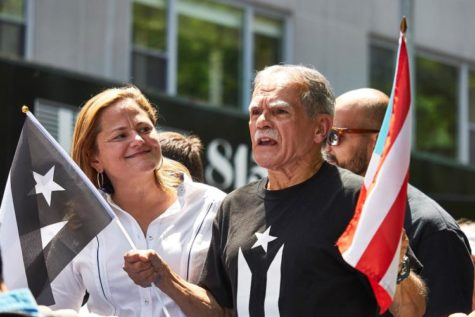 Oscar Lopez Rivera with City Council Speaker Melissa Mark-Viverito on the lead float at this year's Puerto Rican Day Parade.