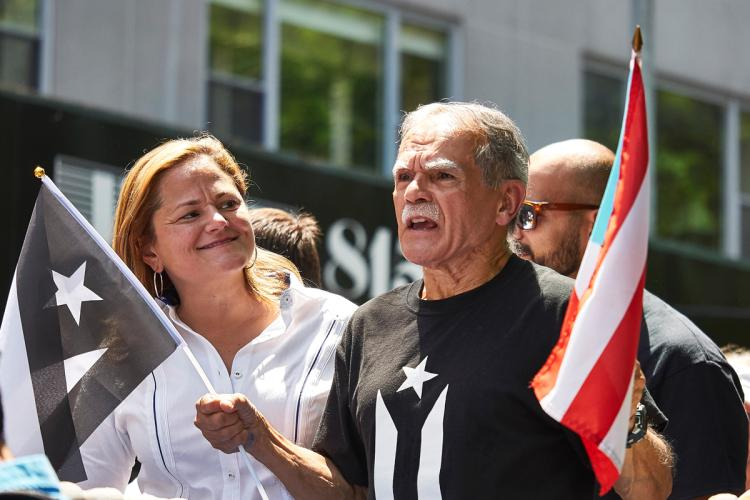 Oscar+Lopez+Rivera+with+City+Council+Speaker+Melissa+Mark-Viverito+on+the+lead+float+at+this+year%27s+Puerto+Rican+Day+Parade.