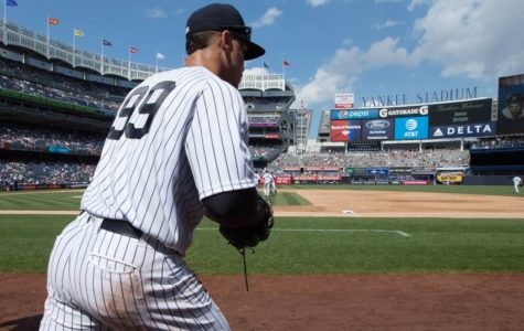 Aaron Judge jogs onto the field.