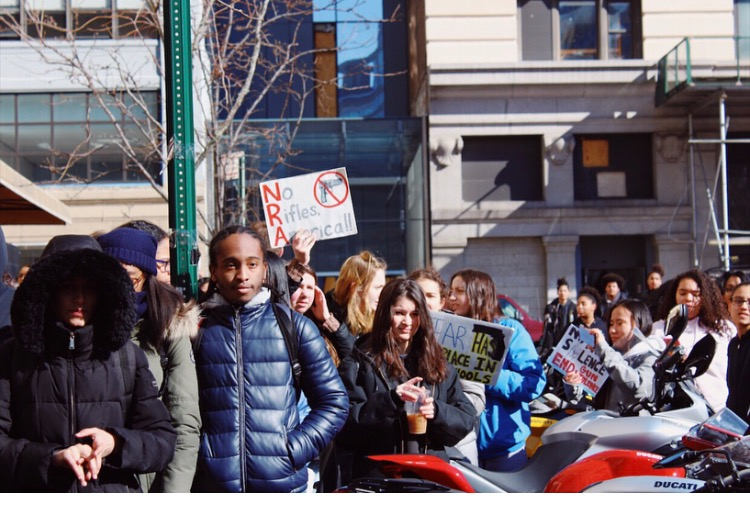 Students at the NYC iSchool hold signs and chant for change.