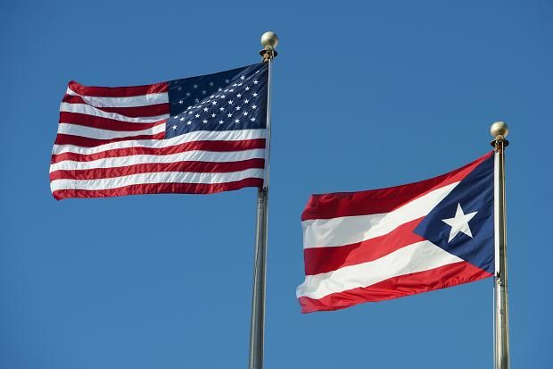 American+Flag+and+Puerto+Rican+flag+waving+together+as+a+sign+of+unity+and+peace+despite+history.+