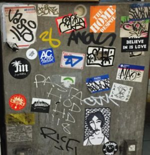 Street art also goes underground into the subways-- here are some stickers on a generator in the Essex Street station in Lower Manhattan.