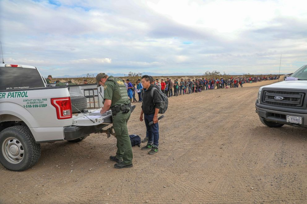 Border Patrol Agents apprehending migrants who crossed over.