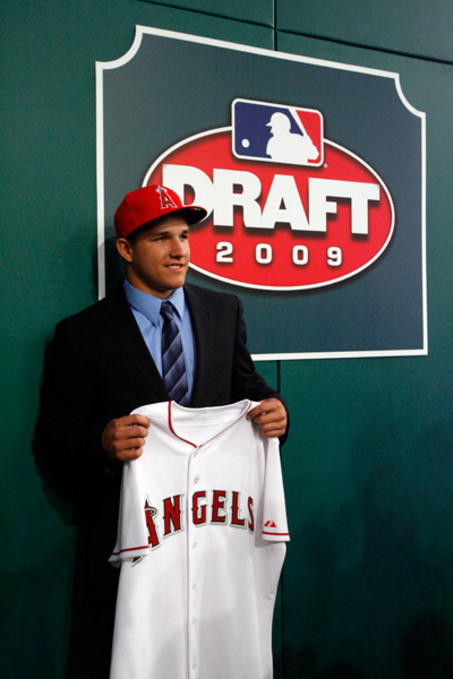 Mike Trout poses with his new uniform after being drafted #25 by the Angels in the 2009 MLB draft.